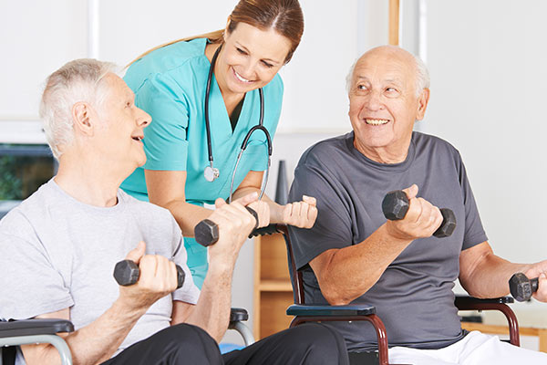 Nurse helping old men with fitness at WLC Firm