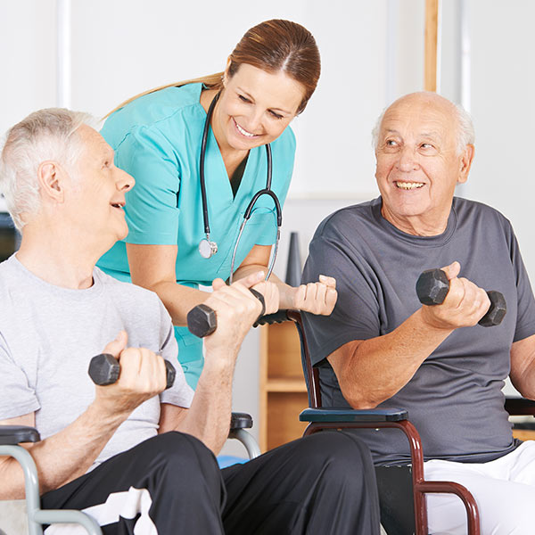 Nurse helping old man with fitness