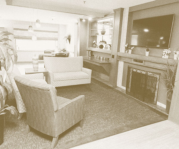 fireplace, recliner, living room, decoration at nursing home
