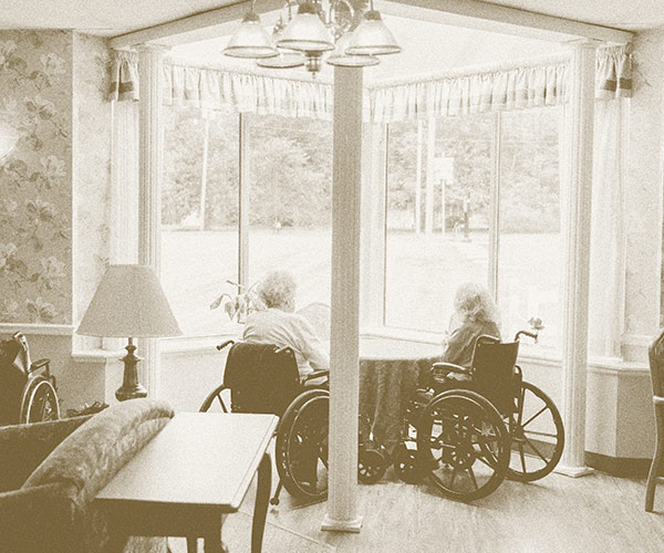 Women looking out window at WLC Carrier Mills Community